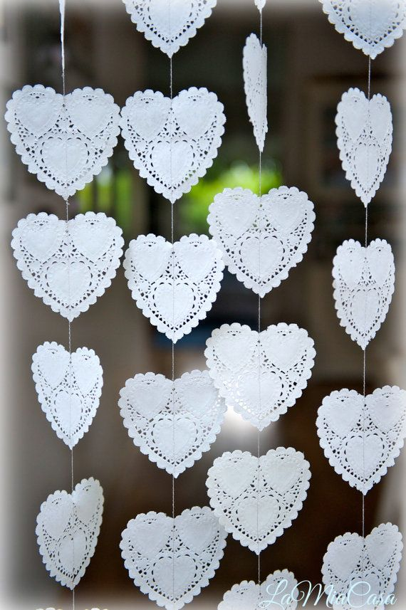 Length of the garland: please choose in the MENU. Size of each doily heart: 4.  Most adorable rustic home decoration, wedding backdrop, wedding curtain!  I have made these lovely garlands with a romantic rustic wedding in my mind :), but it looks equally beautiful as home decor - the delicate hearts turn and create sophisticated atmosphere.  Color: off white.  Decorate your wedding reception with this amazing aesthetic statement! This delicate garland looks just as lovely adorning any corner…