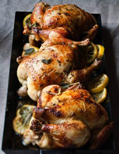 Herb-roasted marinated whole chicken with lemon and sage.