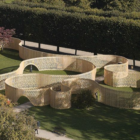 Dutch design studio FABRIC has installed a slatted wooden structure resembling a curvy maze in the garden of Rosenborg Castle in Copenhagen, Denmark.