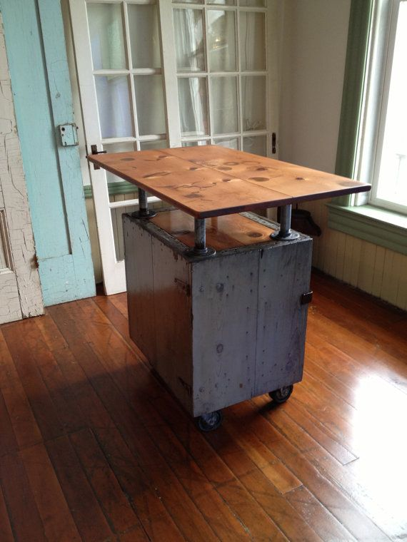 Reclaimed wood industrial kitchen Island on casters, bar, galvanized pipe, grey cedar box, fir top, metal latch. $725.00, via Etsy.
