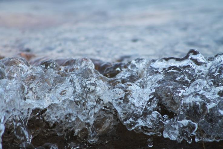 Close up of water splashing onto the beach