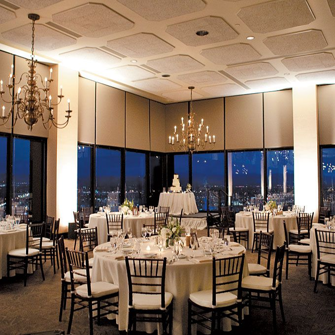 A modern and romantic wedding reception held at The Pinnacle Club at Grand Hyatt Denver via Brides.com.