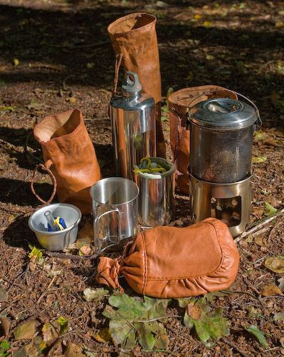 A beautiful leather bushcraft kit by Wayland (Gary Waidson). Water collector, cup, water bottle, brew kit, hobo stove, and cook pot.