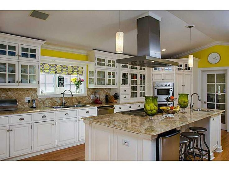 traditional kitchen in white and yellow kitchens board