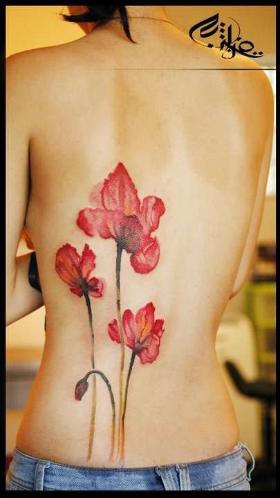 Red poppy watercolor tattoo.