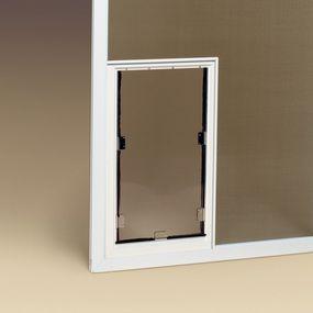 a screen door with a dog doorjust what we need