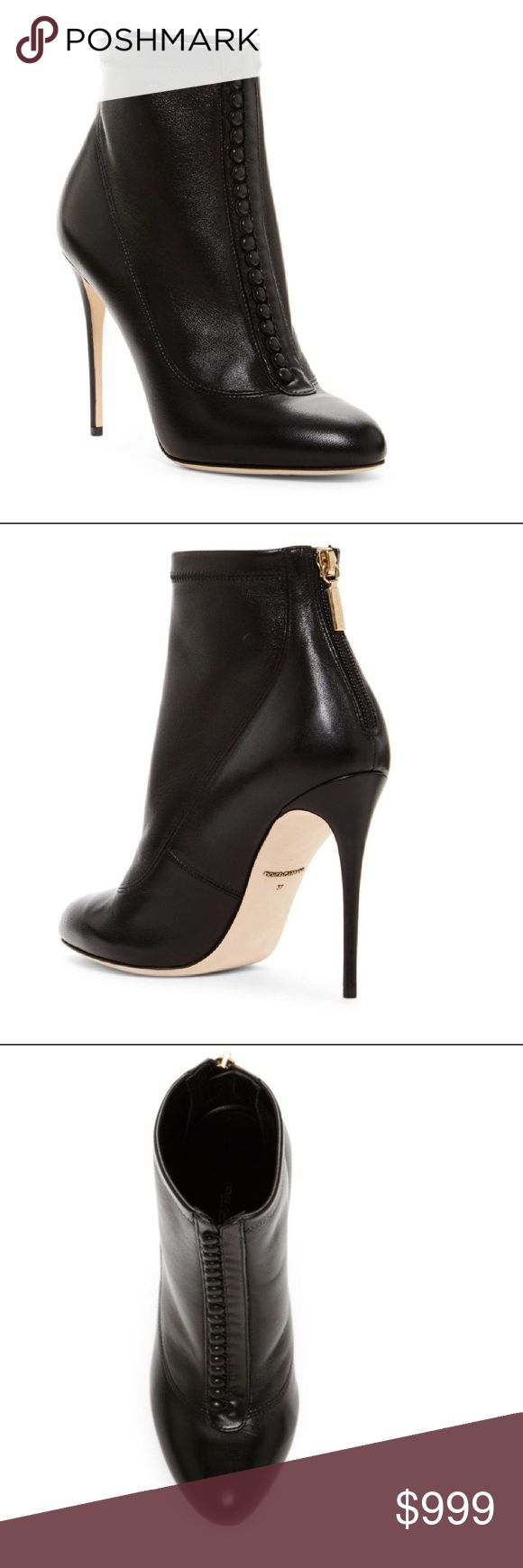 """Brand New Dolce & Gabbana - Button Front Bootie Sizing: True to size. Reference size chart for European conversion.    - Round toe  - Button-up vamp  - Back zip closure  - Lightly padded insole  - Covered stiletto heel  - Approx. 5.75"""" shaft height, 10"""" opening circumference  - Approx. 4"""" heel  - Made in Italy  - Materials: Leather upper, lining, and sole Dolce & Gabbana Shoes Ankle Boots & Booties"""
