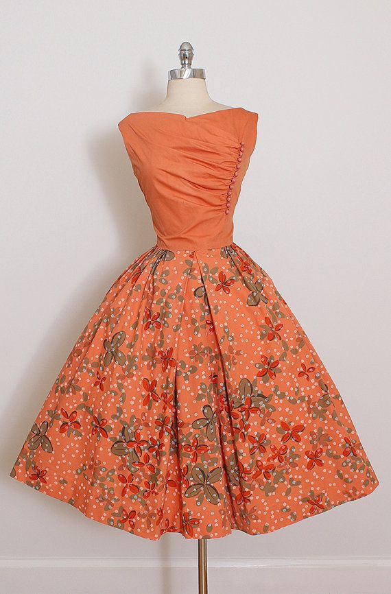➳ vintage 1950s dress * orange cotton * floral print full skirt * offset bubble button details * metal side zipper * by Carlye condition excellent fits like large length 44 bodice length 15.5 bust 42 waist 30 hem allowance 2.5 some clothes may be clippe