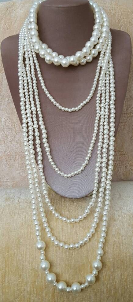 Check out this item in my Etsy shop https://www.etsy.com/ca/listing/510731517/long-multistrand-pearl-necklace-trending