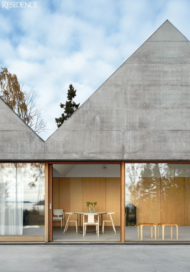 Stockholm house. Grey concrete with orange timber frames