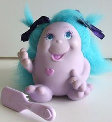 Snugglebumms- probably the weirdest toy I had growing up. Is it a troll? Is it a glow worm?