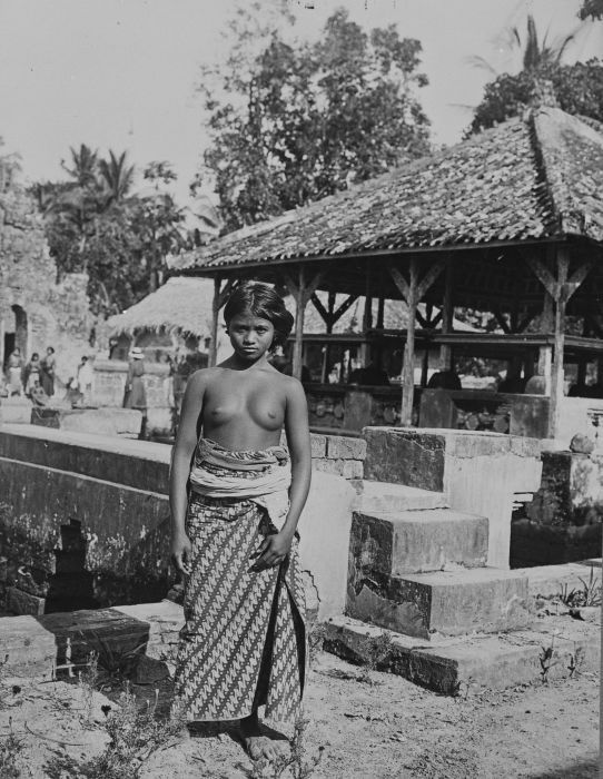 Native Balinese girl at a temple complex in 1922