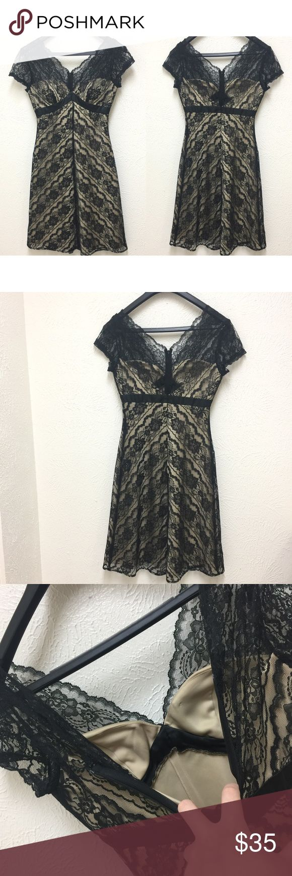 White House Black Market Black Beige Lace Dress 2 See pictures for details and condition.  Size 2 ❌NO Trade ❌Lowball Offer Will be IGNORED&BLOCKED.  ⚡️Serious Buyer ONLY⚡️NO DRAMA! ⭐️Same/next day shipping via USPS ⚠I video record all sales from packing to shipping so we are both protected White House Black Market Dresses