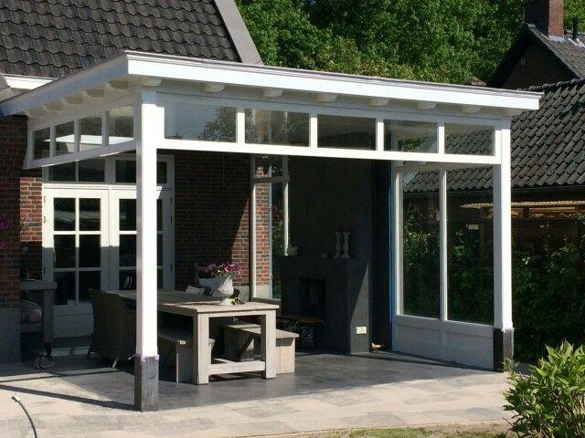 Prachtige veranda met sfeervolle open haard en hardstenen sokkels.  Stijlvol ingericht. Ontworpen en gemaakt door de veranda vakman www.verandaservice.nl