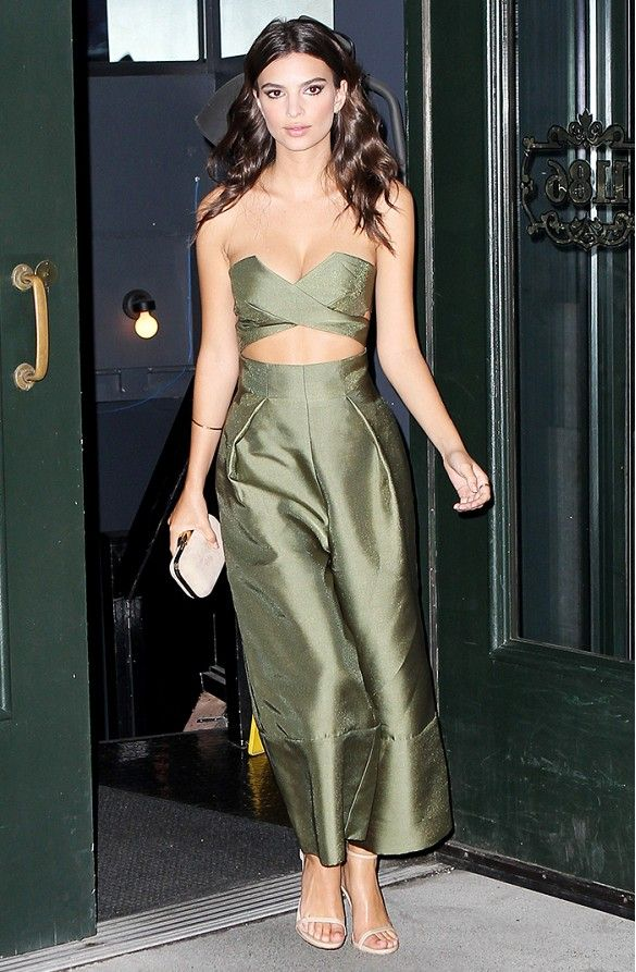 Emily Ratajkowski wears a green jumpsuit with nude heels and a matching clutch
