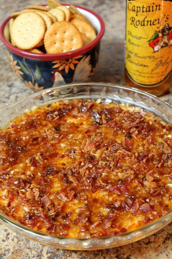 Cheesy baked dip topped with ritz crackers, bacon and Captain Rodney's glaze