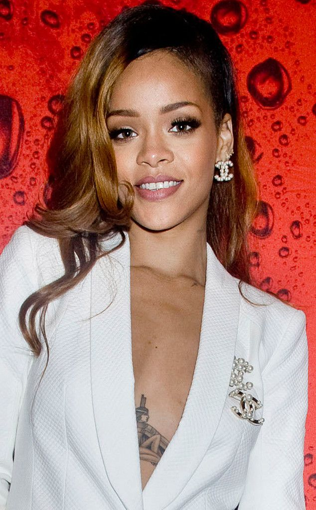 Rihanna looks pretty with golden brown locks and minimal makeup.