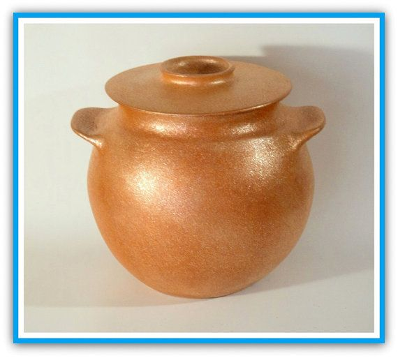 Traditional Bean Pottery -- Like beans? Like to have them around all year long? Clay pots are supposed to be the very best vessel to cook beans in. All handcoiled but dont be fooled by how thin-walled and lightweight micaceous pots may appear, theyre quite resilient, not delicate at all. And you can use them on the stove, in the oven or microwave. Just be careful to avoid rapid changes in temperature like cooking directly on the stove and then running it under very cold water. Clay is much…
