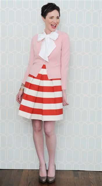 Love the striped skirt paired with the pink cardigan.  And the blouse bow over the cardigan makes it extra cute.