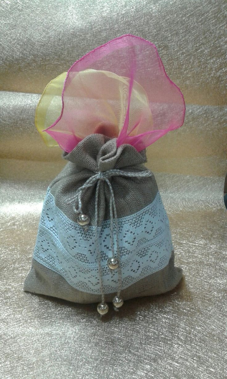 Jute potli with colourful tissue fabric. Various 6 flavours of syrup bottles kept inside the potli. Give aways wedding favours.
