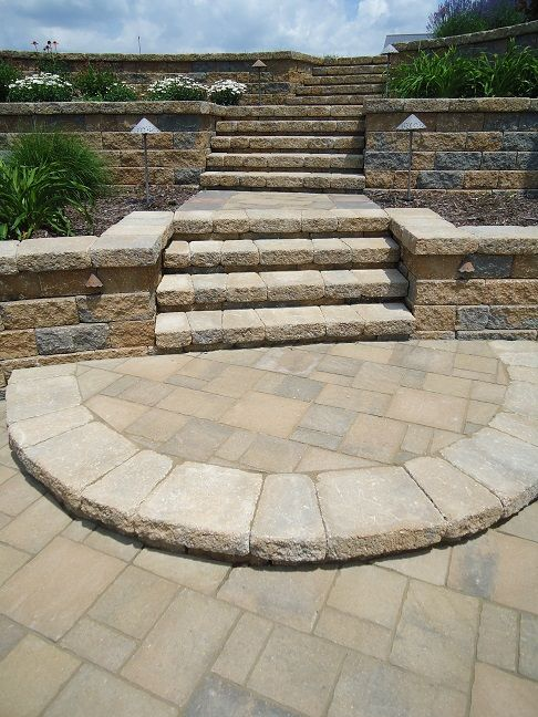 Brick Paver Steps through a tiered wall system installed by Wihebrink Landscape Management, Inc. located in Warsaw IN and Syracuse IN serving Ft. Wayne IN, Culver IN, Winona Lake IN, Lake Wawasee, Lake Tippecanoe, Warsaw IN, Syracuse IN, Columbia City IN, and Logansport IN. Providing Landscape Installation, Landscape Renovation, Landscape Design, Irrigation and Sprinkler Installation, Sprinkler Service and Repairs, and Lawn Fertilization & Weed Control. Website: www.wlminc.biz