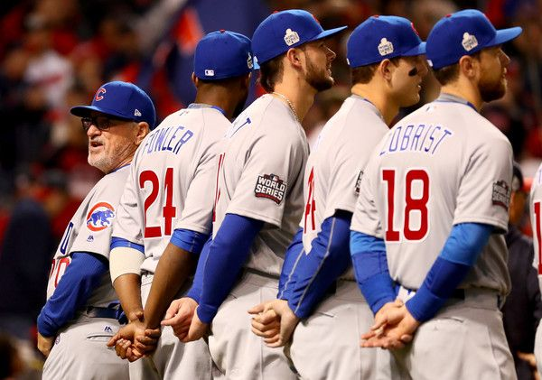Manager Joe Maddon #70, Dexter Fowler #24, Kris Bryant #17, Anthony Rizzo #44 and Ben Zobrist #18 of the Chicago Cubs look on prior to in Game One of the 2016 World Series against the Cleveland Indians at Progressive Field on October 25, 2016 in Cleveland, Ohio.