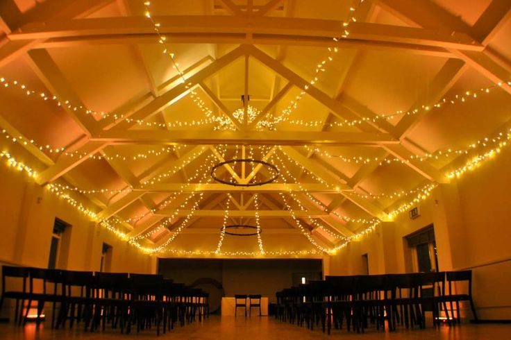 Gold uplighting for a warm, candlelit feel during the ceremony at Stoke Place