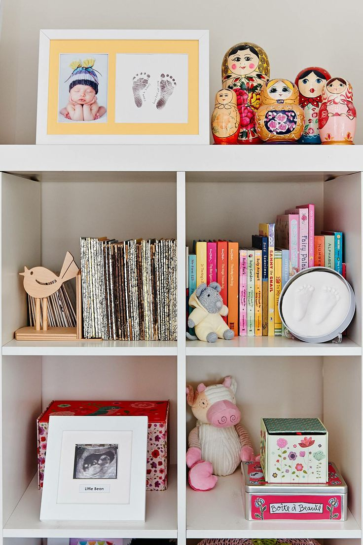 Bookcase for baby bedroom filled with keepsakes to cherish.  Ultrasound Frame, Baby Impression and Baby Footprints.
