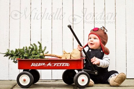Christmas time is here!! baby pulling wagon with christmas tree.: