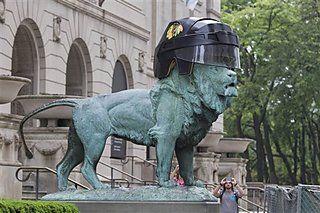 Two massive bronze lions that guard the Art Institute of Chicago sporting custom made Blackhawks helmets.