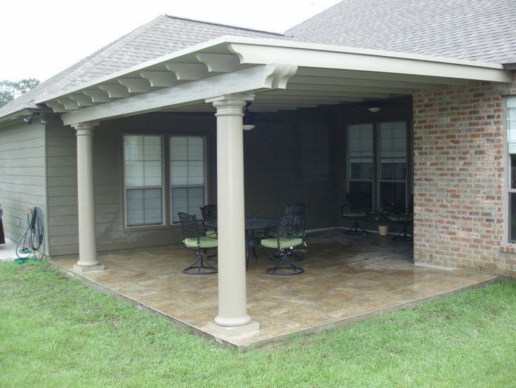 Covered patio using Snap-N-Lock™ Panel roof, circular columns and Permawood scalloped rafters.