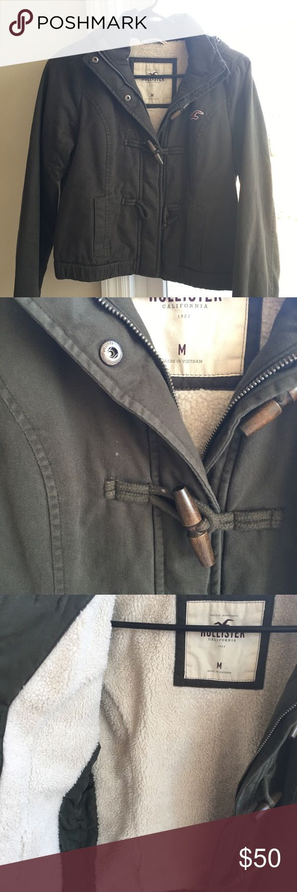 Hollister Jacket Very nice and warm jacket. Fairly new, but have small white spots on the front (shown in the second picture). Cropped. Hollister Jackets & Coats