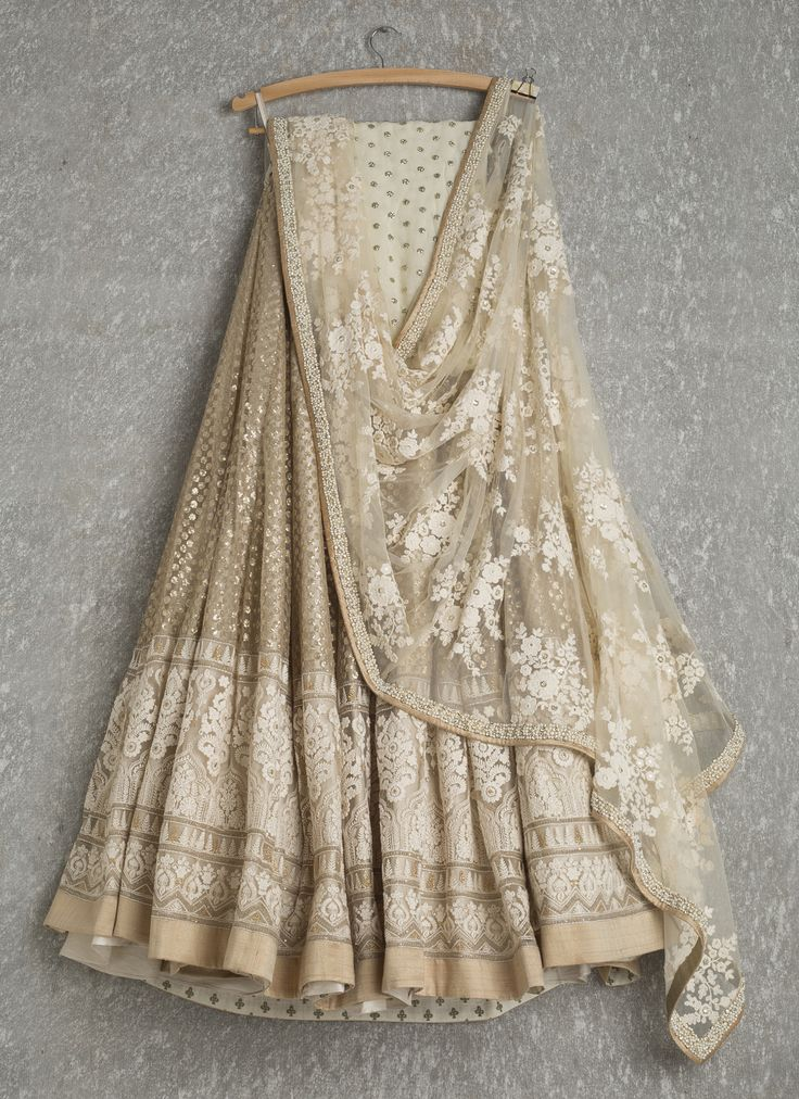 Lehengas by SwatiManish : Gold lehenga with white threadwork dupatta