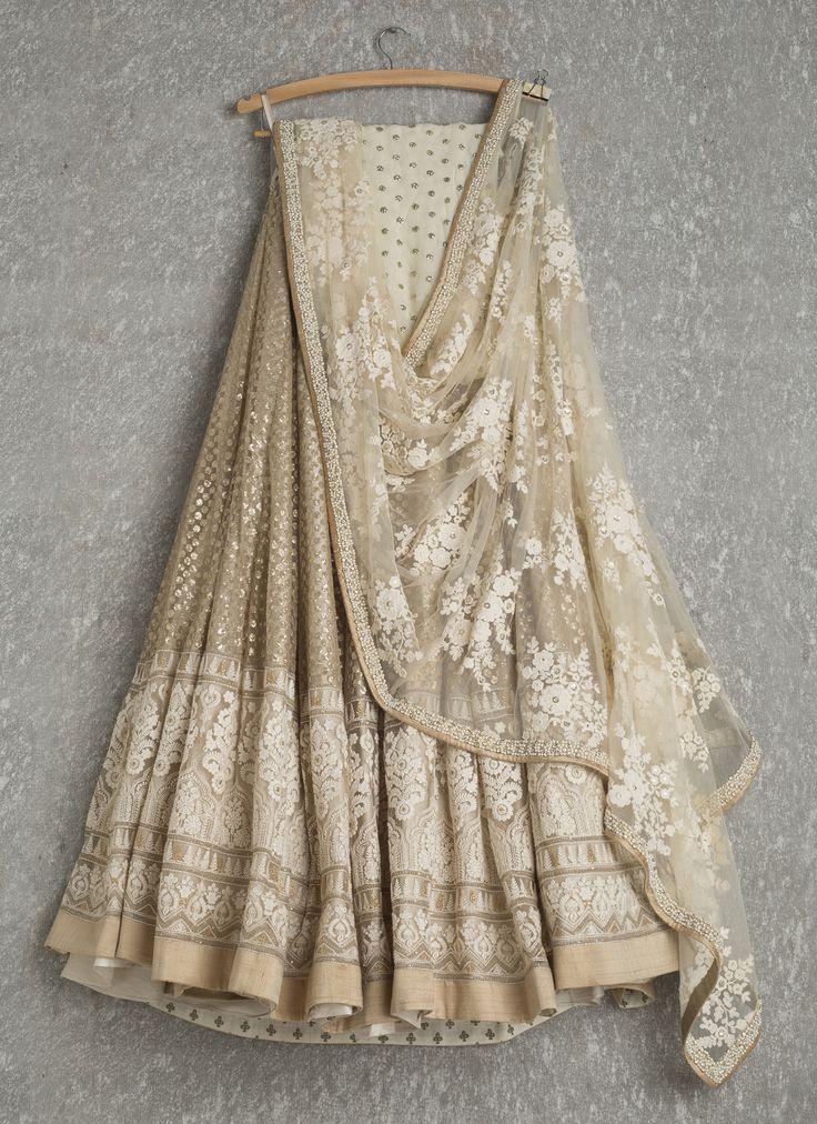 Lehengas by SwatiManish : Gold lehenga with white threadwork dupatta
