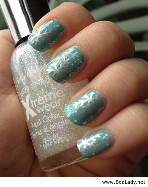 Light teal with silver metallic snowflakes winter nail art