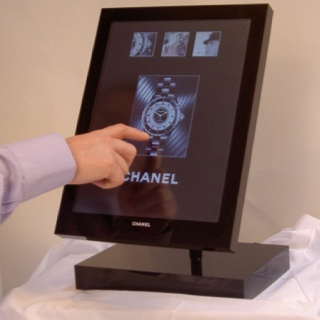 Interactive touch screen designed and produced by H Squared for CHANEL J12 watches to be used in retail stores to browse products and see functions and watch content about the superb mechanics of the product