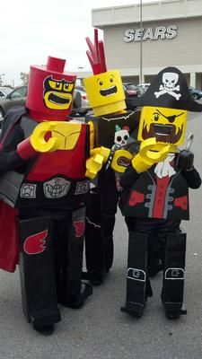 Lego Kids Costumes: This year I decided to make Lego men costumes for my kids.   I used cardboard for the bodies, which I covered in joint compound. I sanded them, primed