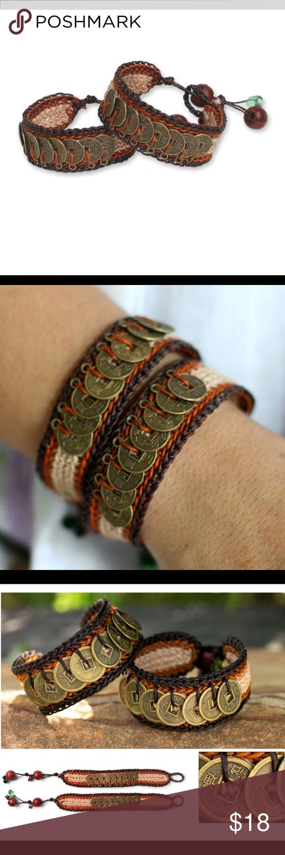 Chinese Brass Coins Orange Brown Crochet Bracelets This handmade creation is offered in partnership with NOVICA, in association with National Geographic. These bracelets feature replicas of Chinese coins in brass and are crafted with wood and glass beads.  Product Features: Color: Orange/white/brown Design based on Feng Shui Brass replicas of Chinese coins, thought to bring wealth and success Two handmade bracelets are crocheted and adorned with rain tree wood and glass beads Toggle clasp…