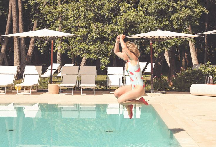 Come As You Are, Crocs style blogger travel Italy swimsuit swimming pool happy smile
