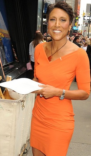Robin Roberts. I admire her for beating cancer.