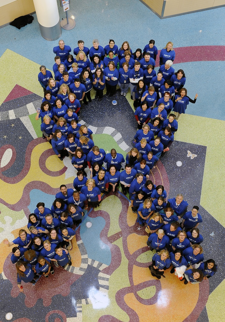 "Check out our ""Livin' Blue Ribbon"" in recognition of Child Abuse Prevention Month! We gathered in the hospital atrium with our friends from The Kempe Foundation to make a human blue ribbon to raise awareness of child abuse."
