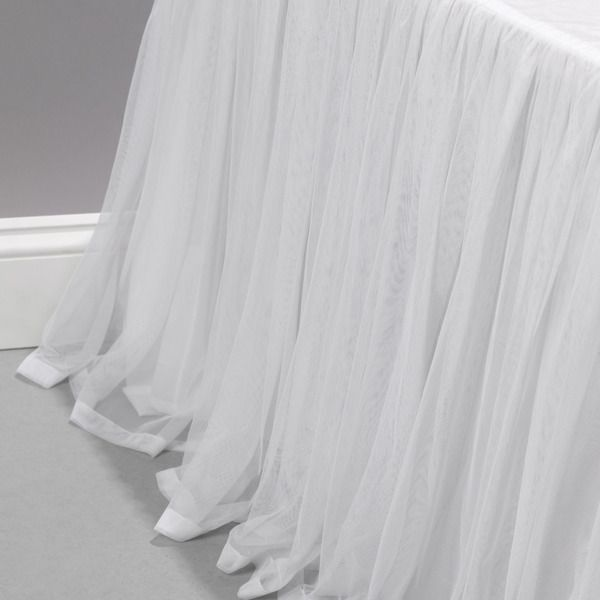 Couture Dreams Whisper White Bed Skirt is sophisticated and romantic. This bedskirt will give a room a bed a custom look.  Gathered to perfection and lined this bed skirt is sure to be stunning in any room.