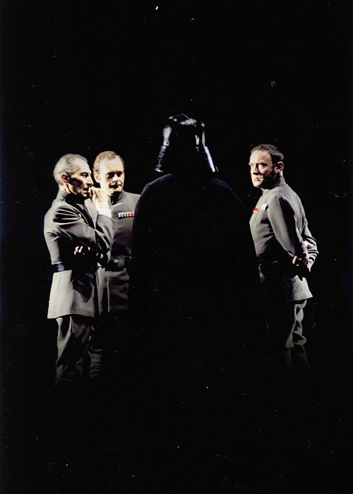 Governor Tarkin, Admiral Motti, General Tagge, and Lord Vader