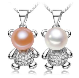 Cute little bear pendant necklaces of freshwater pearls Chain is 17.5 inches Available in White Or Pink Purple sold out.  Free Shipping