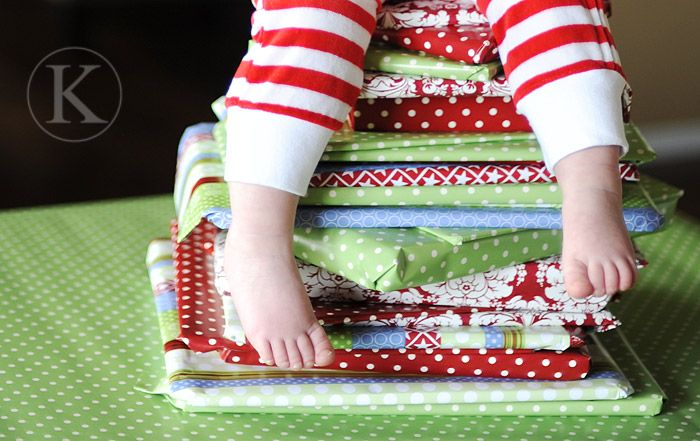 Wrap 24 christmas books you already own.  Kids get to pick which one is read that day. Stack under kids tree in bedroom. Half the fun of presents is unwrapping them. What a fun tradition.