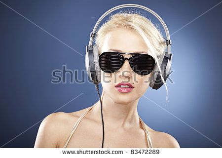 Portrait of a blonde girl with black sunglasses and headphones.
