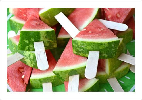 Healthy lollies! Just a triangle of juicy watermelon and a stick for a yummy snack for everyone.