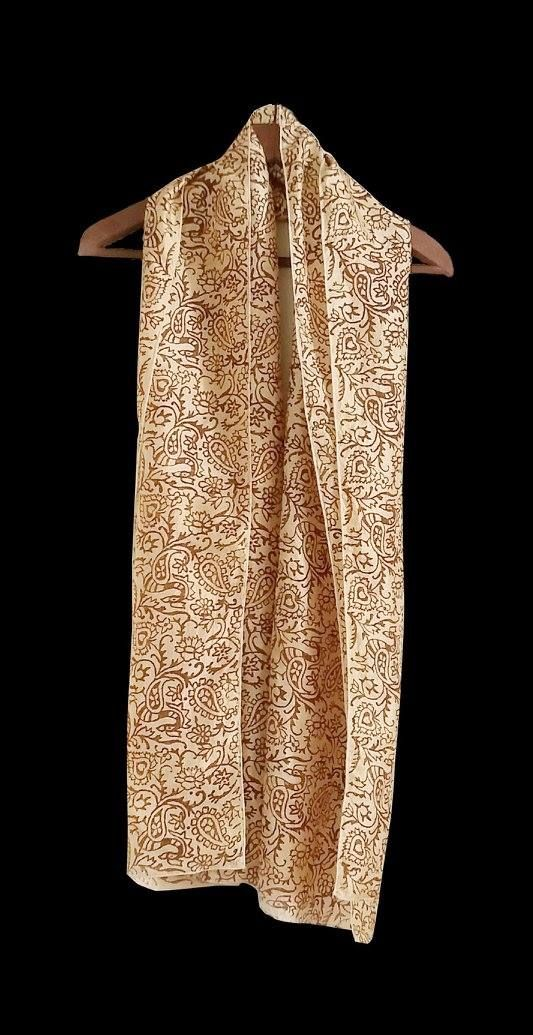 """Pure silk long scarf dyed beige, with dark brown paisley print. Can be worn with a shirt or a jacket. Size: 23""""x78"""""""