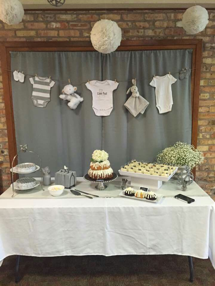 Bunt cakes,  lemon parfaits,  cupcake liner balls, clothes line, grey and white baby boy shower.