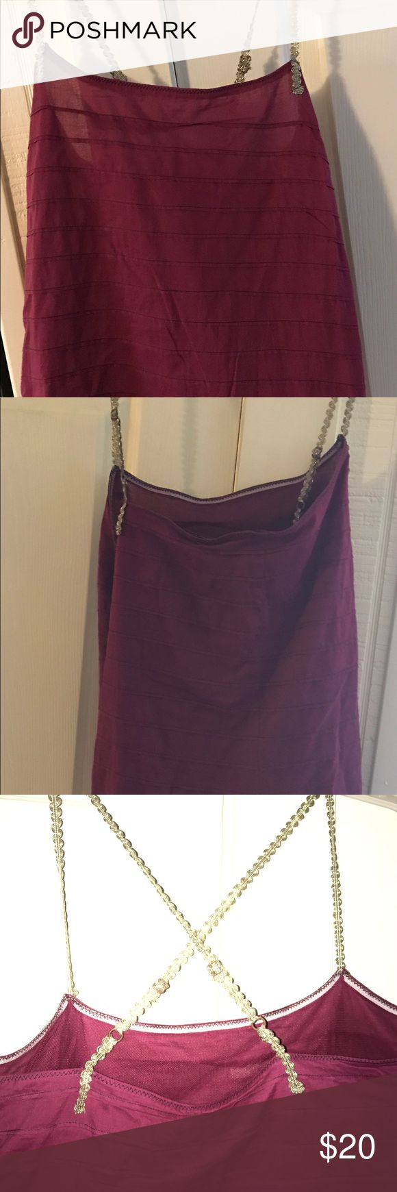 Free People Top Free People wine and gold strappy top. Sheer underlay at the bottom adds interest. Gold braided adjustable straps cross in the back, making the top adorable whether you're coming or going! Side zip for easy on/off, size 10 Free People Tops Tank Tops